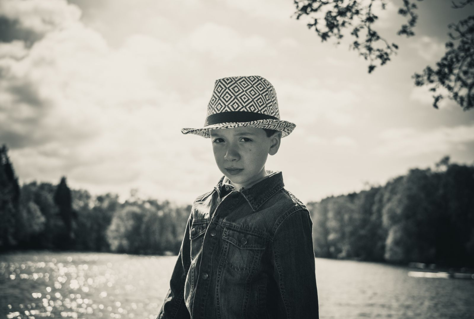 Boy in hat at Coppice Pond, Bingley, UK